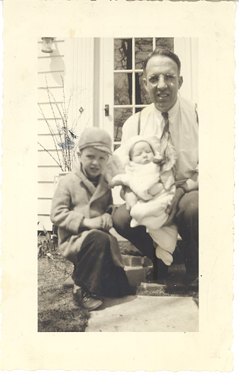 My grandfather holding my mother, with my uncle alongside in 1939.
