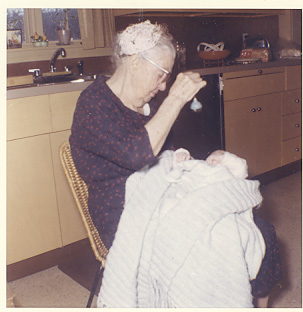 My great grandmother holding me in my grandmother's kitchen in 1961.