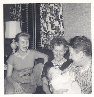 My mother, Nana, and F.G. holding me in their home in 1961.